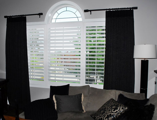 Blinds layered with drapes