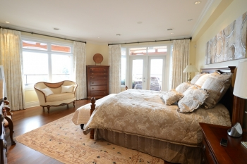 Victorian inspired bedroom with cream drapes | The Well Dressed Window - Hunter Douglas Blinds