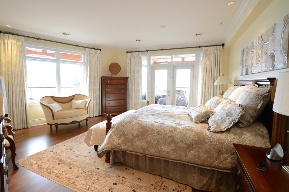 Victorian inspired bedroom with cream drapes
