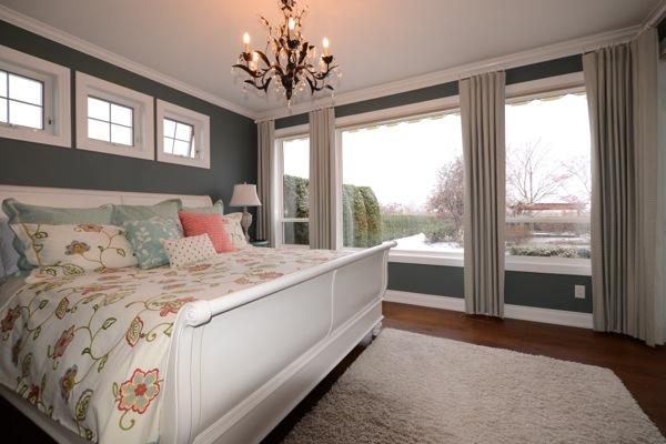 Floor to ceiling blackout drapery in master bedroom