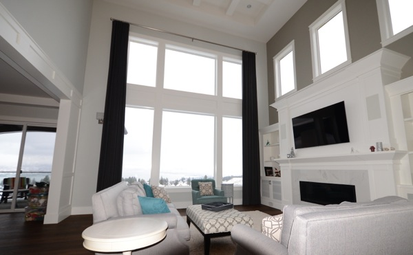 High ceilings with large windows and custom drapery