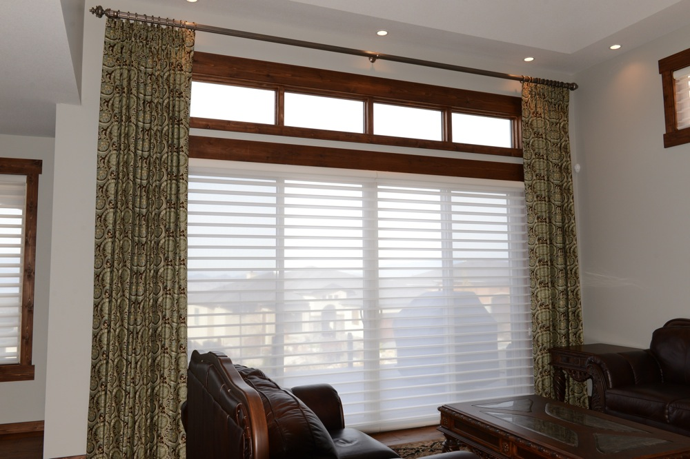 Blinds and drapes by The well dressed window