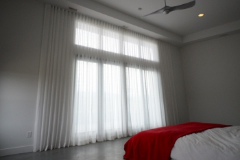 The Well Dressed Window custom floor to ceiling sheer drapes | The Well Dressed Window - Hunter Douglas Blinds