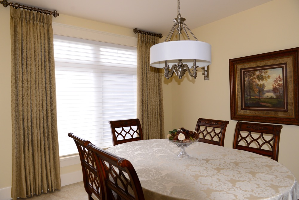 Traditional style dining room with Hunter Douglas silhouettes