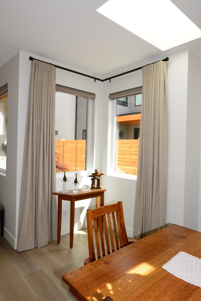 Custom drapes in corner window for contemporary Kelowna home