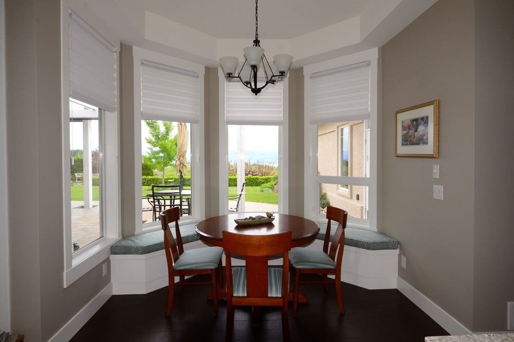 Hunter Douglas shades in bay window of breakfast nook