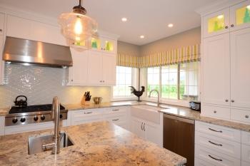 Hunter Douglas Window Treatments Kelowna | custom roman shades in kitchen