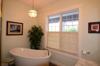 Hunter Douglas Window Treatments Kelowna | Custom top down bottom up roman shade in bathroom