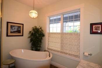 Hunter Douglas Window Treatments Kelowna | Custom top down bottom up roman shade in bathroom