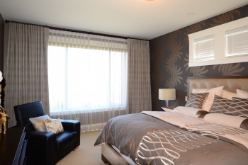 Hunter Douglas Window Treatments Kelowna | Beautiful sheers and blackout drapery in bedroom