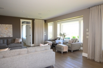 Hunter Douglas Window Treatments Kelowna | Custom blackout drapery in great room