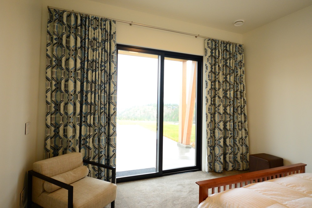 Hunter Douglas Window Treatments Kelowna | Custom Print Blackout Drapes in bedroom