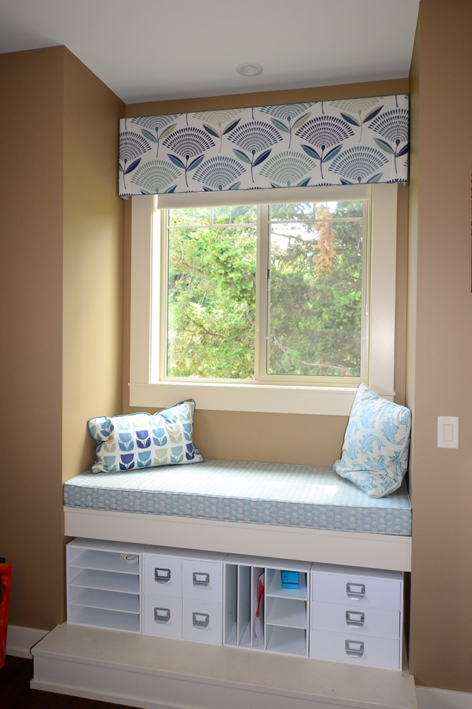 Window seat with custom upholsetry and matching roman shade | The Well Dressed Window