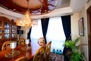 Rich velvet drapes in dining room