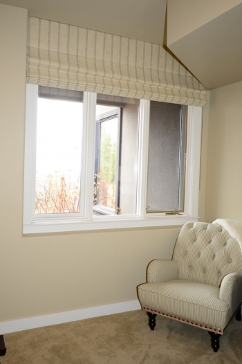 Roman shade is the perfect window treatment for a problematic corner