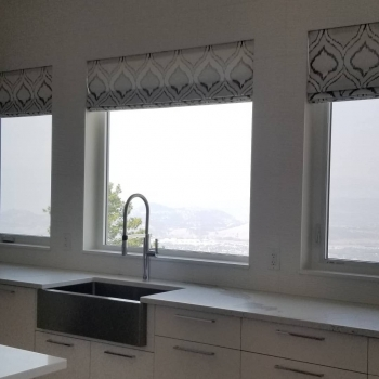Custom roman shades kitchen window treatment | The Well Dressed Window Kelowna